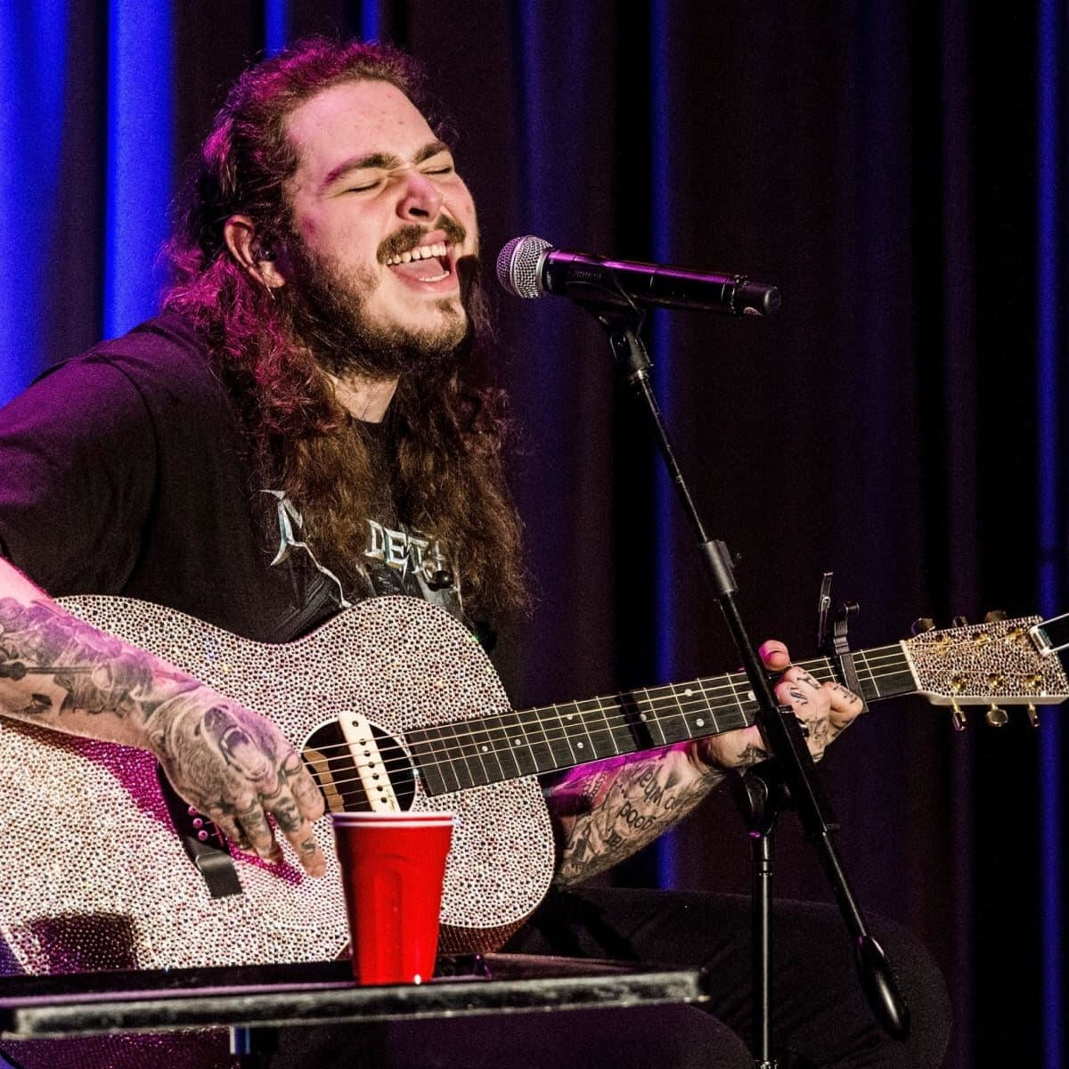 """Watch Post Malone Grab a Guitar and Debut His New Moody Sound With """"Stay"""" - Maxim"""